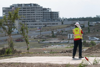 Bob Hill, a heavy mobile equipment mechanic with the U.S. Army Corps of Engineers' Philadelphia District, surveys the tornado-stricken landscape of Joplin, MO.