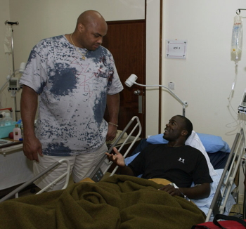 Charles Barkley visiting a military hospital during a USO tour to a forward-deployed location in 2005