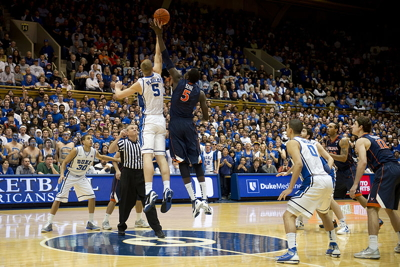 Duke University and University of Virginia basketball players scramble for the ball in Durham, N.C., Jan. 12, 2012 (Wikimedia Commons, D. Myles Cullen)