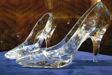 Pair of crystal glass slippers made by Dartington Crystal, on show in the Council House, Plymouth Civic Centre (Wikimedia Commons, Glamhag)