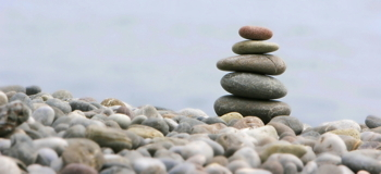round stones for meditation on blurred background