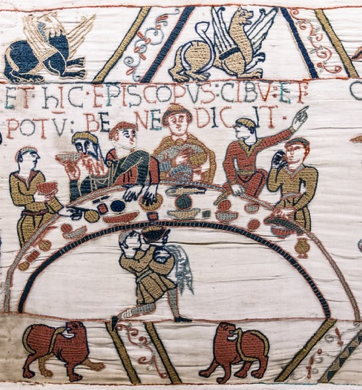 Bayeux Tapestry Scene 43: Bishop Odo blesses the first banquet that Duke William and the Norman barons hold on English soil.
